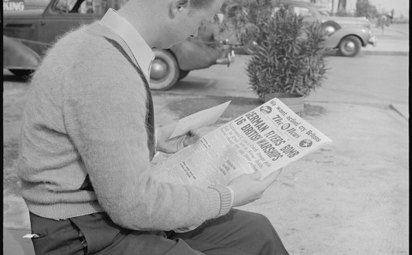 lossy-page1-600px-Los_Angeles,_California._Lockheed_Employment._Cause_and_Effect._This_young_man_reading_the_war_news_holds_an..._-_NARA_-_532213.tif